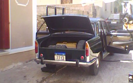 peugeot 404 stopped outside the doctors house